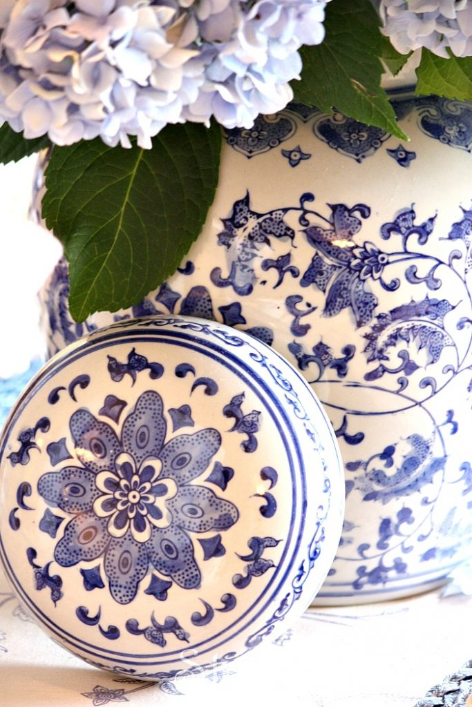 blue and white chinoiserie ginger jar filed with blue hydrangeas