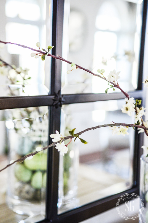 faux bloom twigs in an easy easter decor diy
