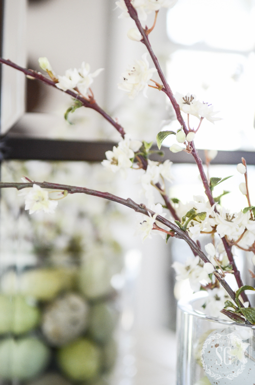 pretty white faux blooming branches in an easy Spring arrangement