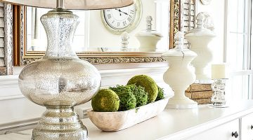 decorate for spring after Easter with moss balls in a wooden dough bowl