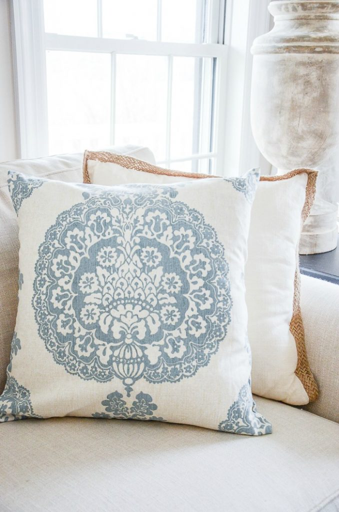 blue and white pillow on a sofa