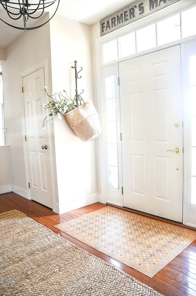 front door and foyer with sisal rug