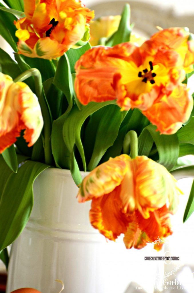 orange parrot tulips in a white pitcher are a easy last minute Easter idea.
