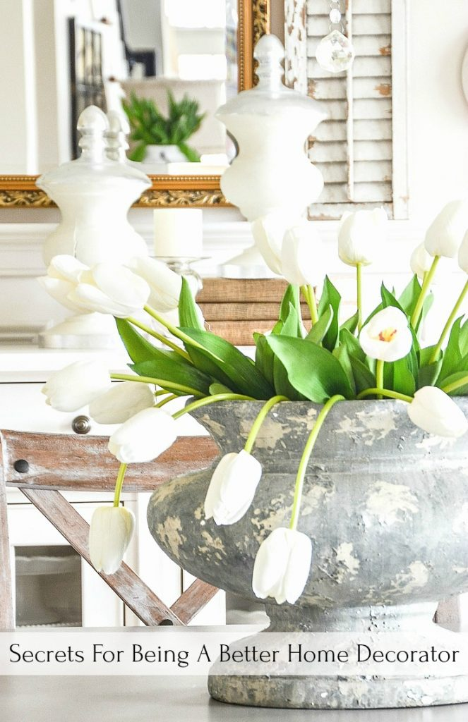 dining room table with an urn of tulips on it