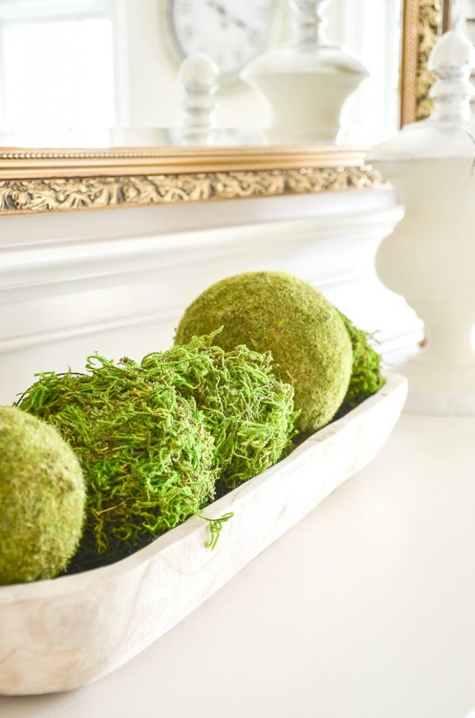 moss balls in rustic dough bowl on the dining room table