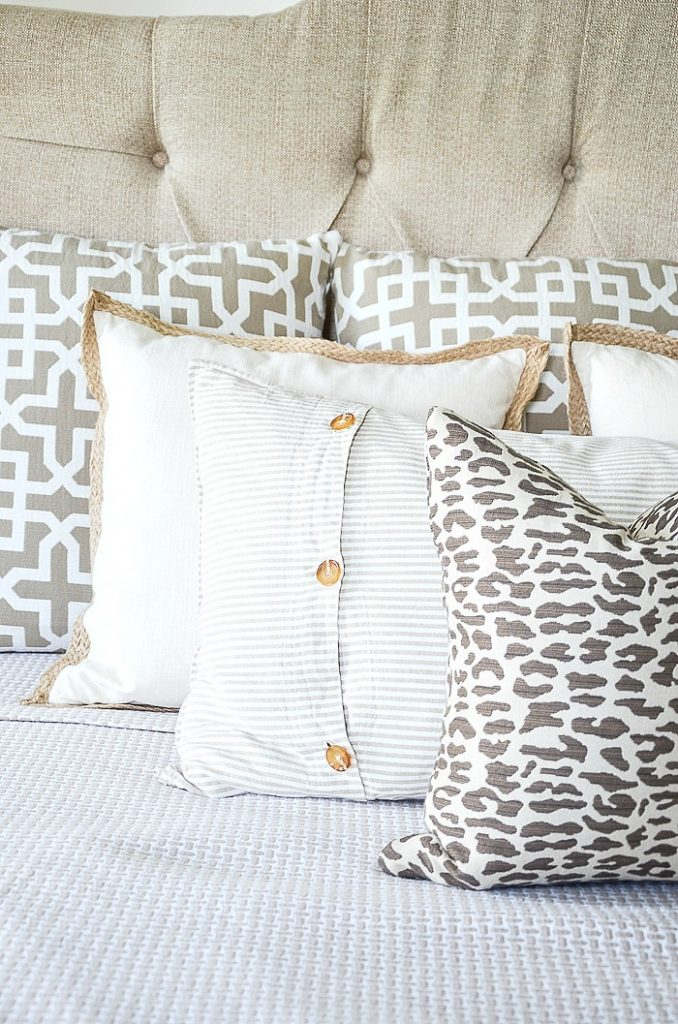 close-up of pillows on a bed
