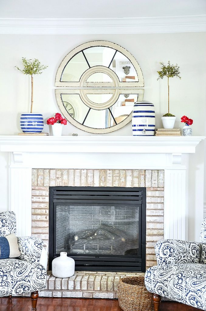 summer mantel with blue and white and hot pink garden roses