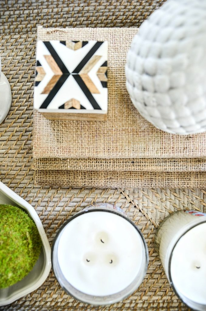 burlap covered books to decorate a coffee table.