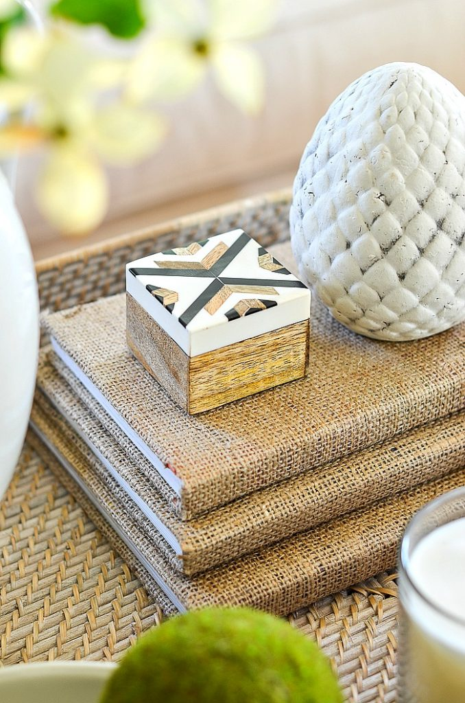 coffee table accessories, little box on a stack of burlap covered books