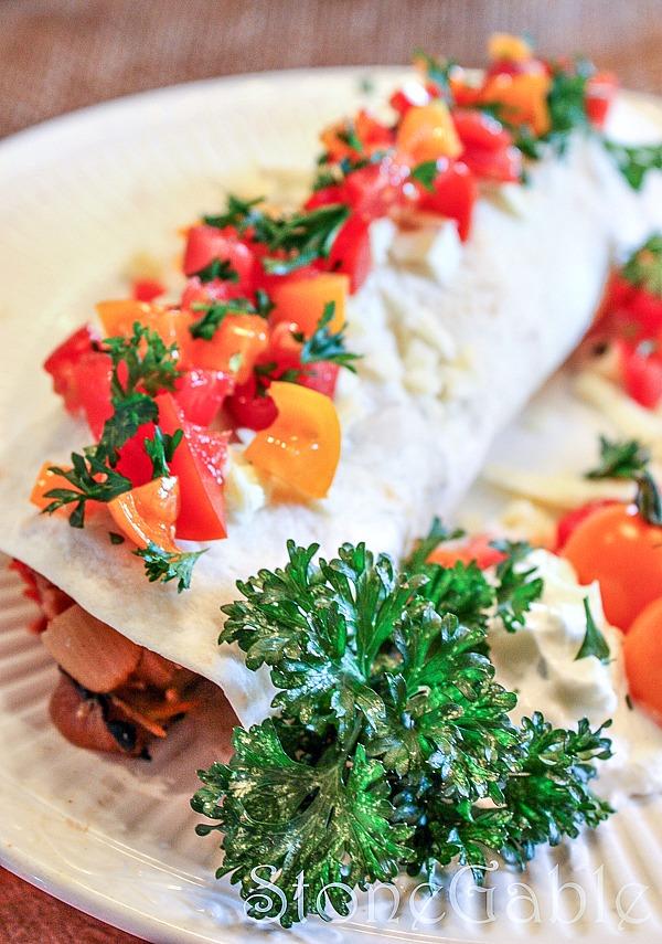 killer fajita garnished with red and orange tomatoes