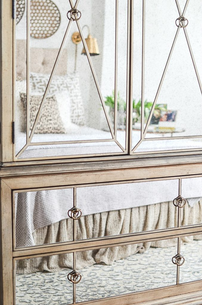 mirrored armoire in bedroom