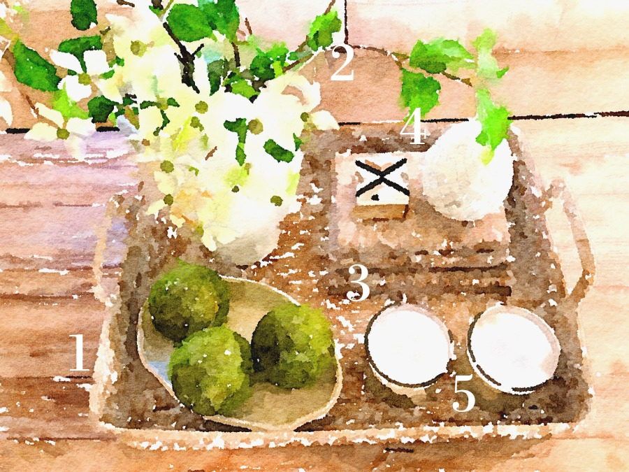 watercolor rendering of a coffee table vignette