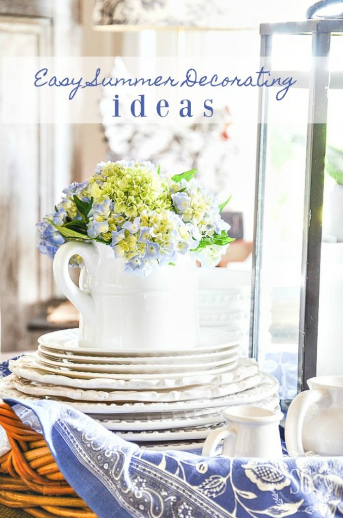 blue and green hydrangeas in a short pitcher