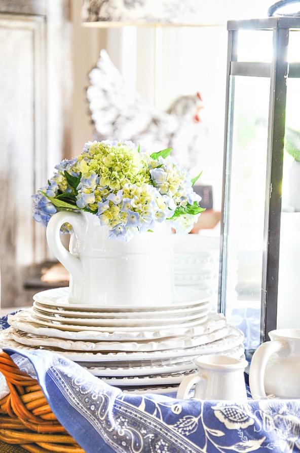 summer vignette with white pitcher of hydrangeas