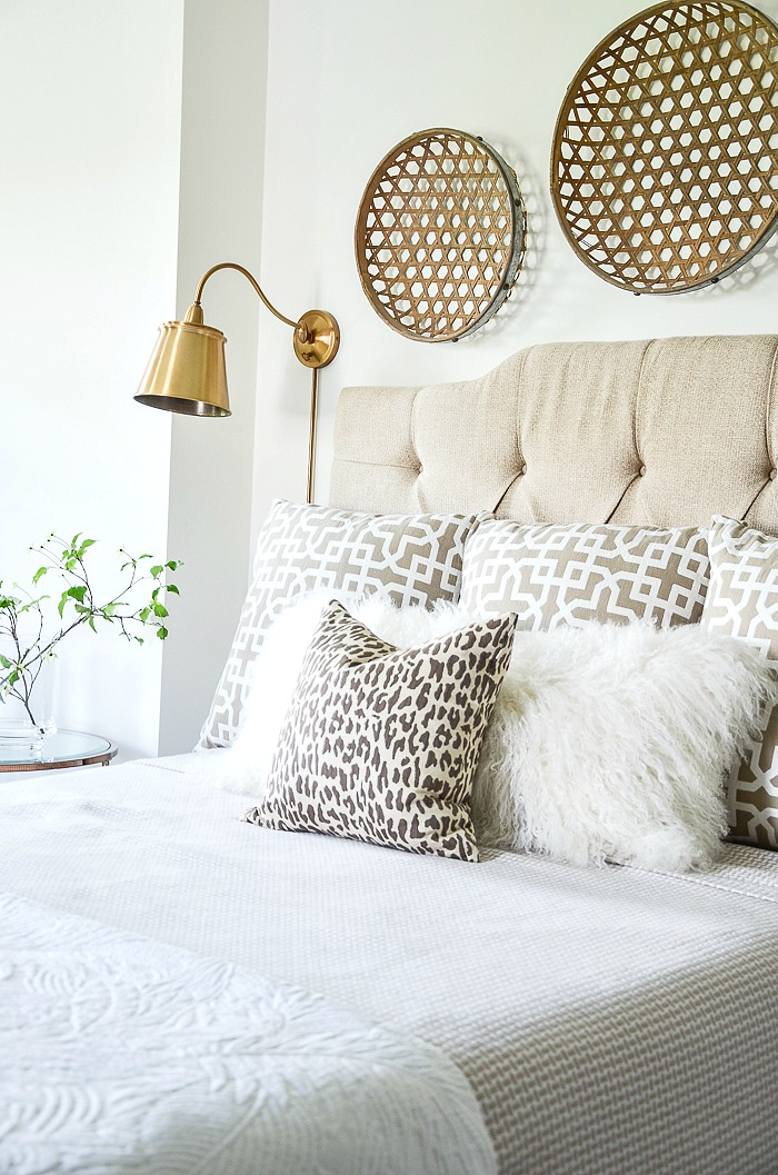 pillows piled hight on a bed