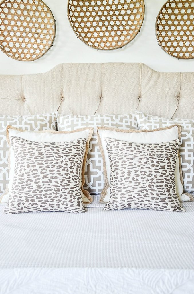 monochromatic pillows on a bed