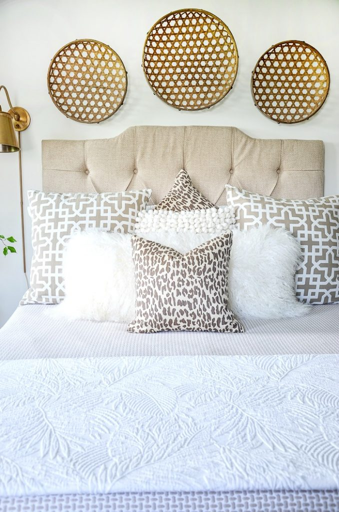 bed with layers of pretty pillows