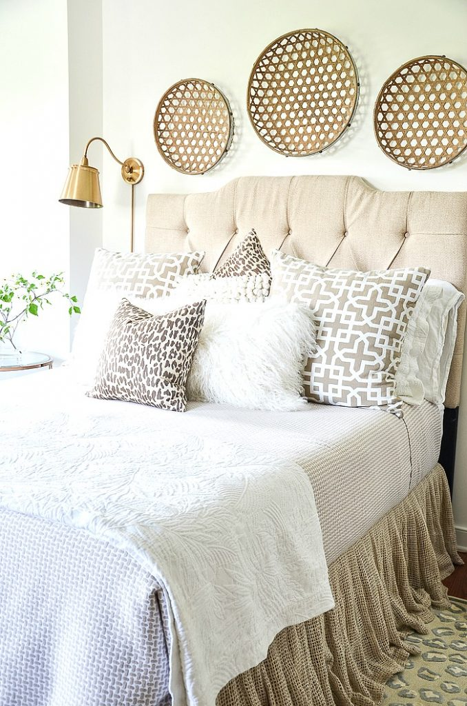 pretty bed with lots of pillows
