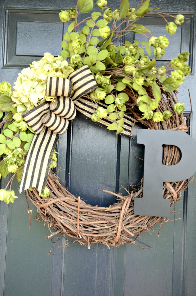 summer wreath on a front door is a great summer decorating idea