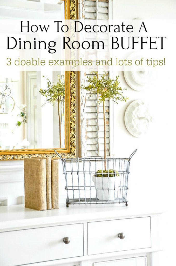 dining room buffet with gold mirror above it