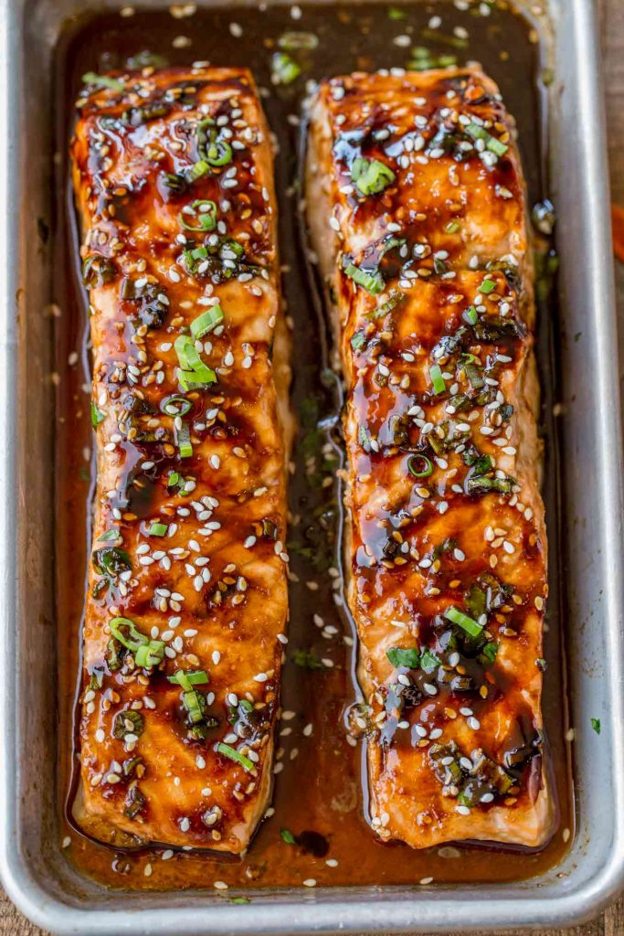 two long salmon steaks on the menu