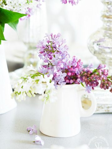 lilacs in a white pitcher in a decluttered home