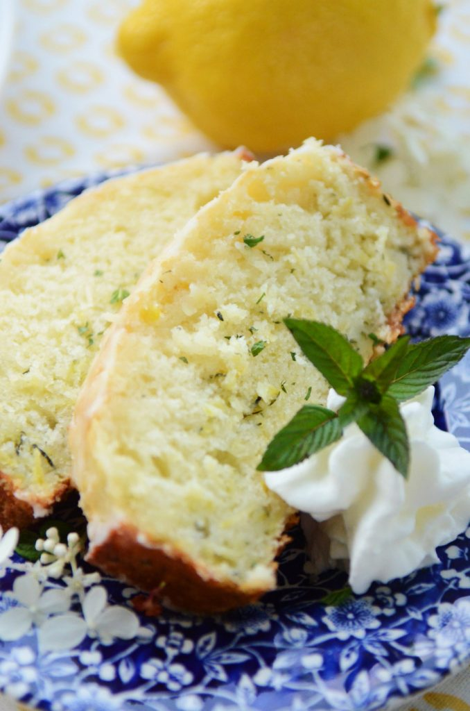 lemon zucchini cake slices on a blue and white plate
