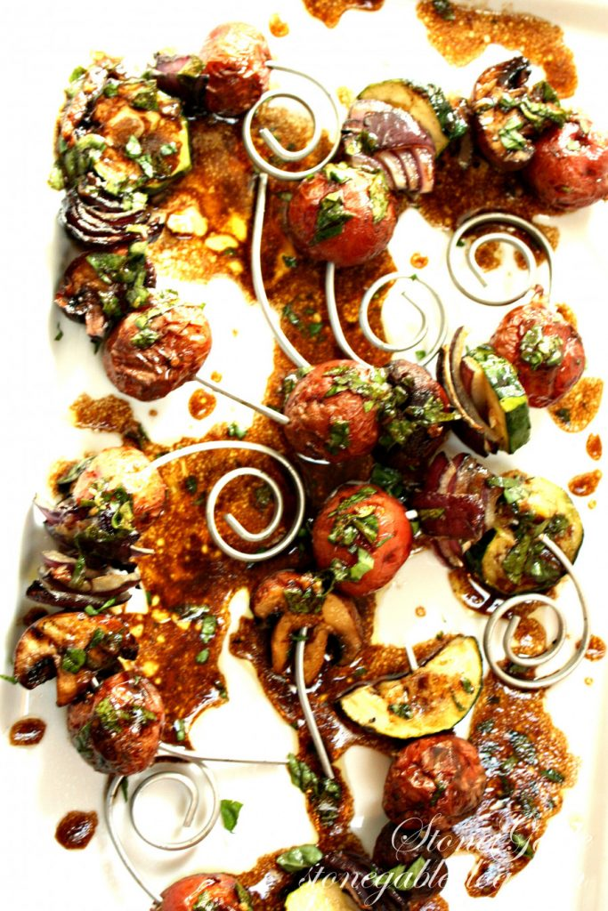 roasted vegetables on curly skewers