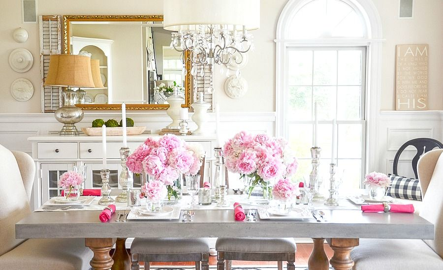 long view of a table filled with peony bouquets