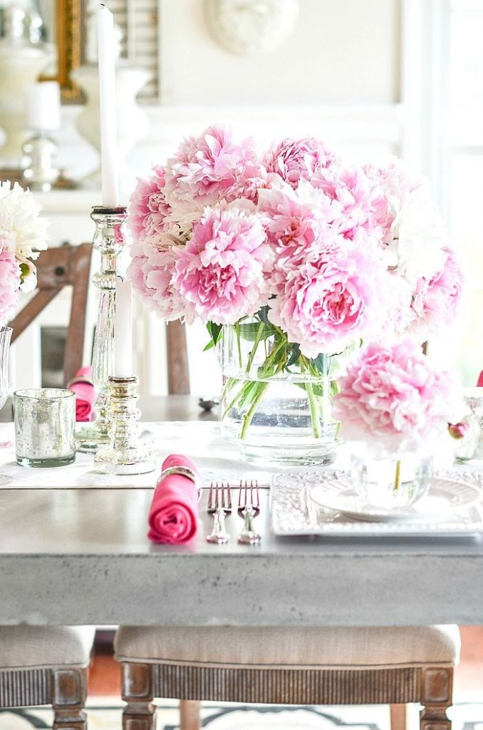 big pink peonies in vases as a centerpiece on a tablescape