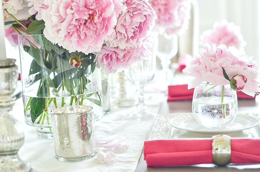 peony tablescape filled with white dishes. Perfect for a bride's table