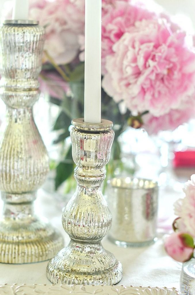 silver candlesticks on a peony tablescape