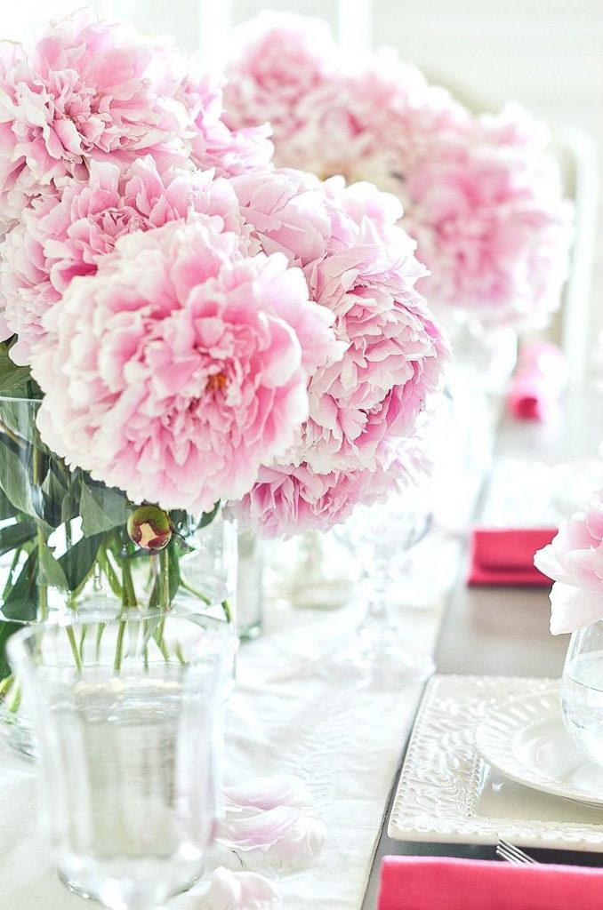 pin moppy head peonies down the center of a table