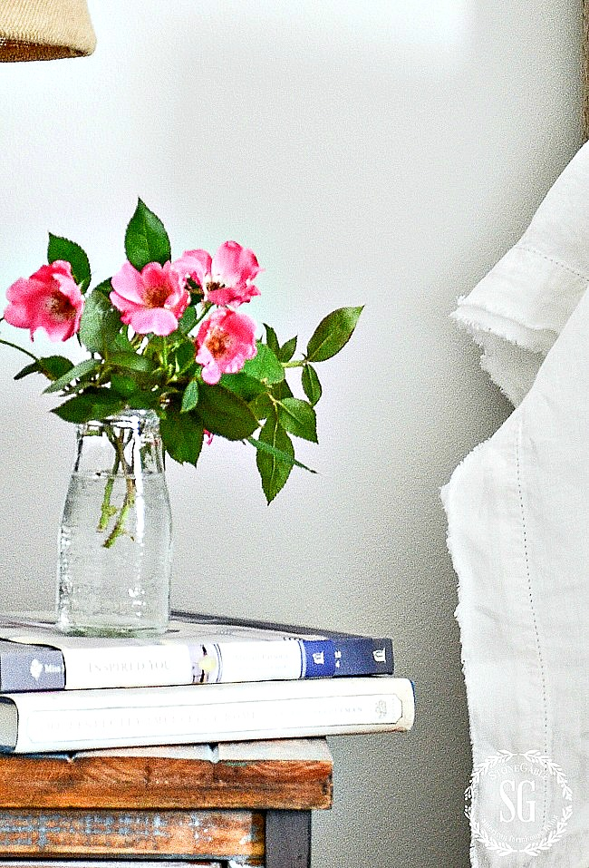 pink garden roses on a bedside table