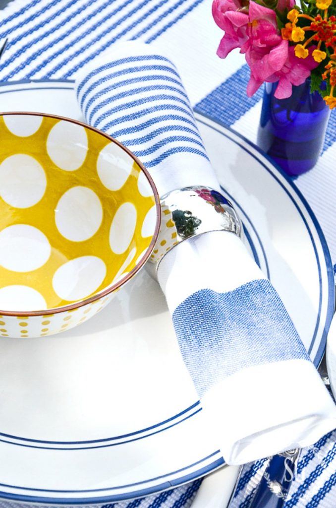yellow polka dot bowl on top of a blue and white plate