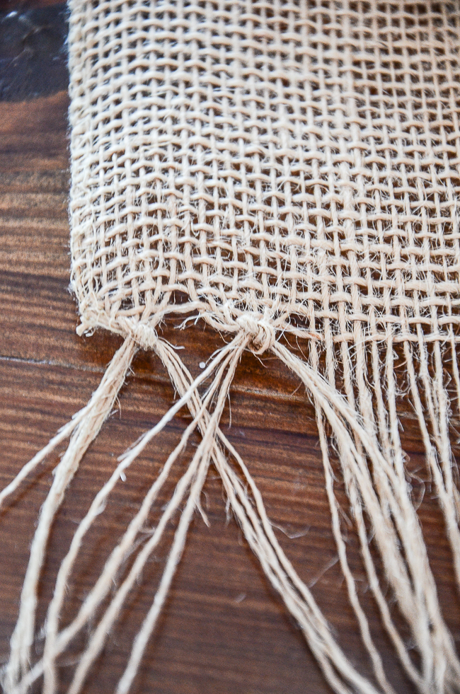 tying know fringe on a burlap table runner