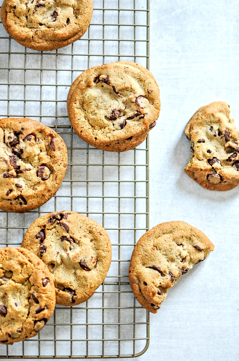 chocolate chip cookies cooking on a rack