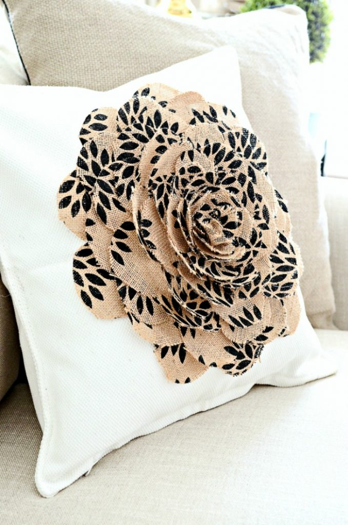 white pillow with big burlap flower on it