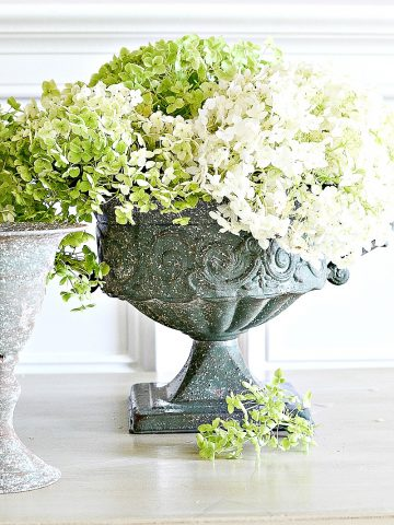 dried green hydrangeas in rustic urns