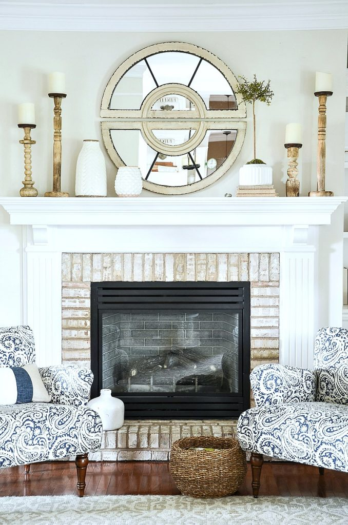 mantel decor with large round mirror