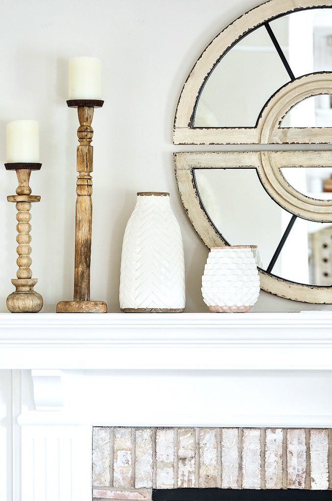white pottery on a decorated mantel