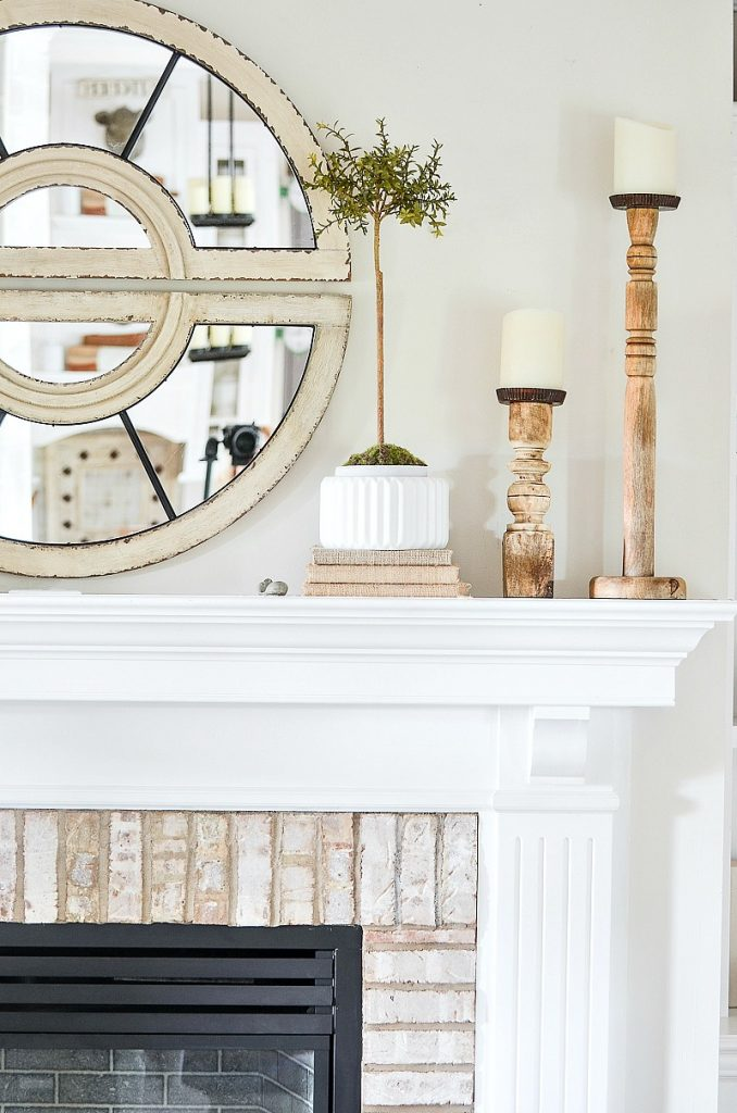 tall topiary in white pottery on a mantel