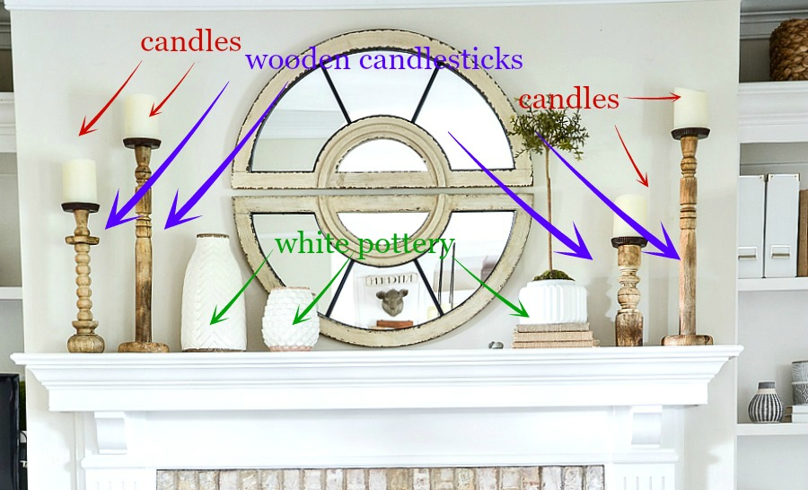 decorating a mantel with candlesticks, pottery and a topiary
