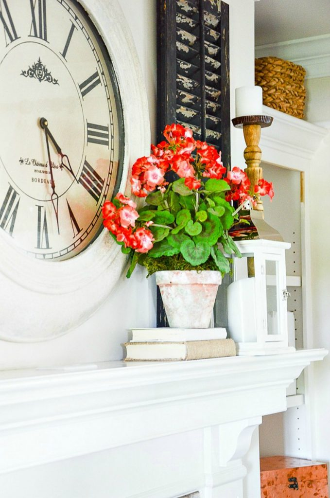 summer mantel decorated with geraniums