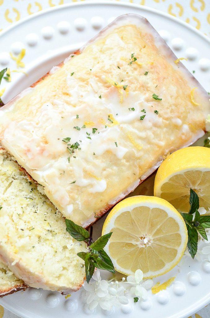pretty lemon zucchini bread on a white plate summer dessert recipe