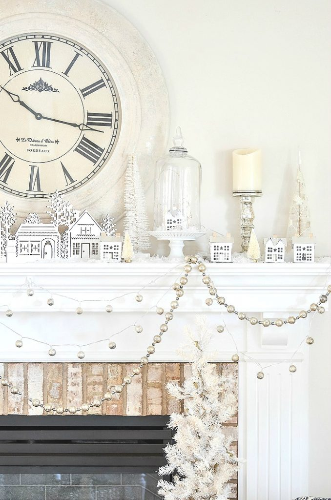 Christmas mantel decorated with white houses