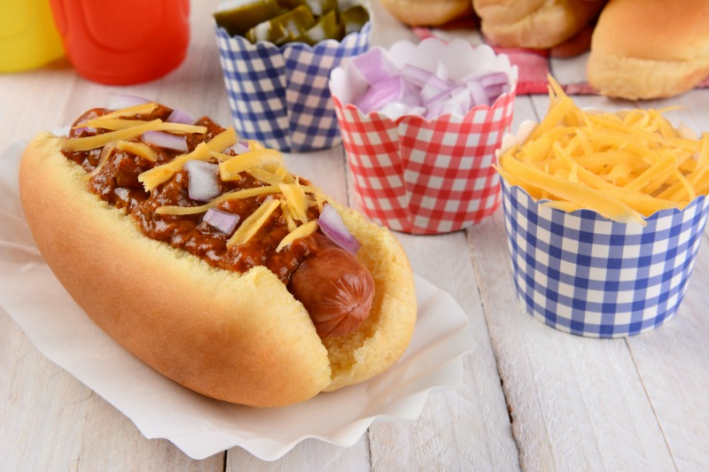 gourmet hot dogs in disposable hot dog tray on the menu