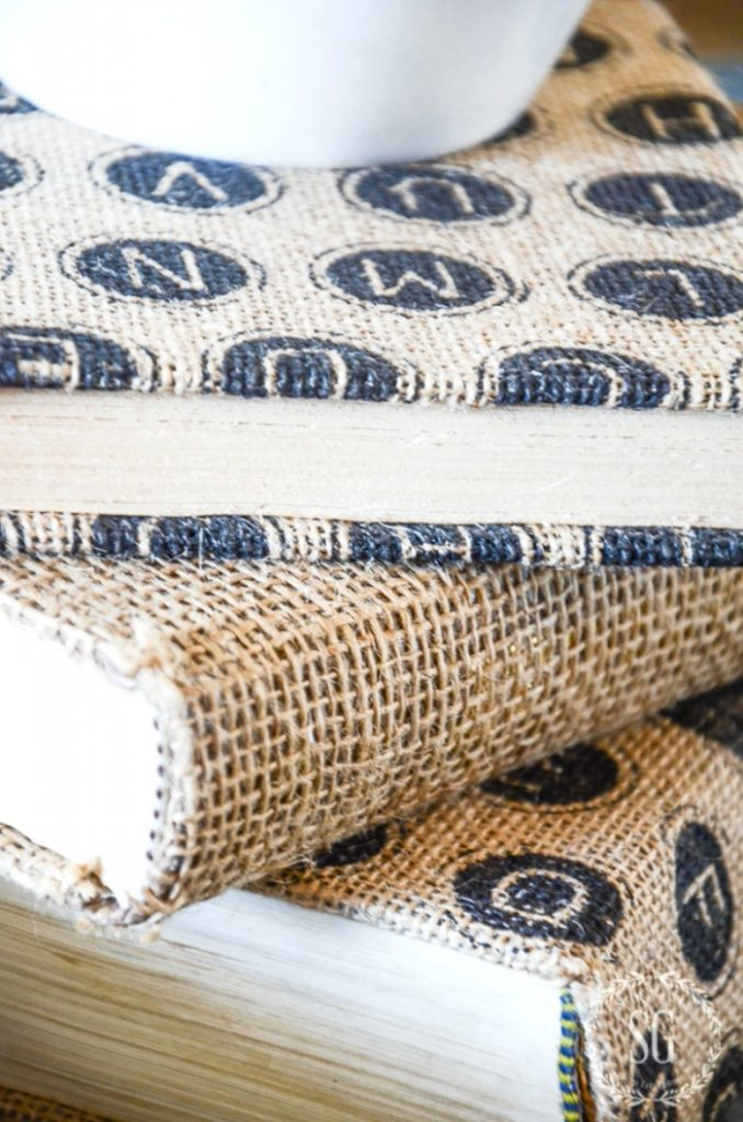 close up of burlap covered books