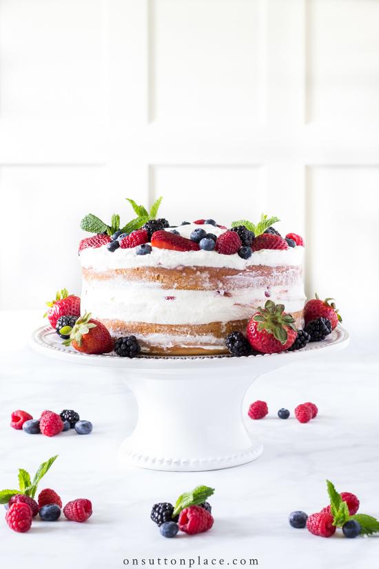pretty iced cake with berries summer dessert recipe.