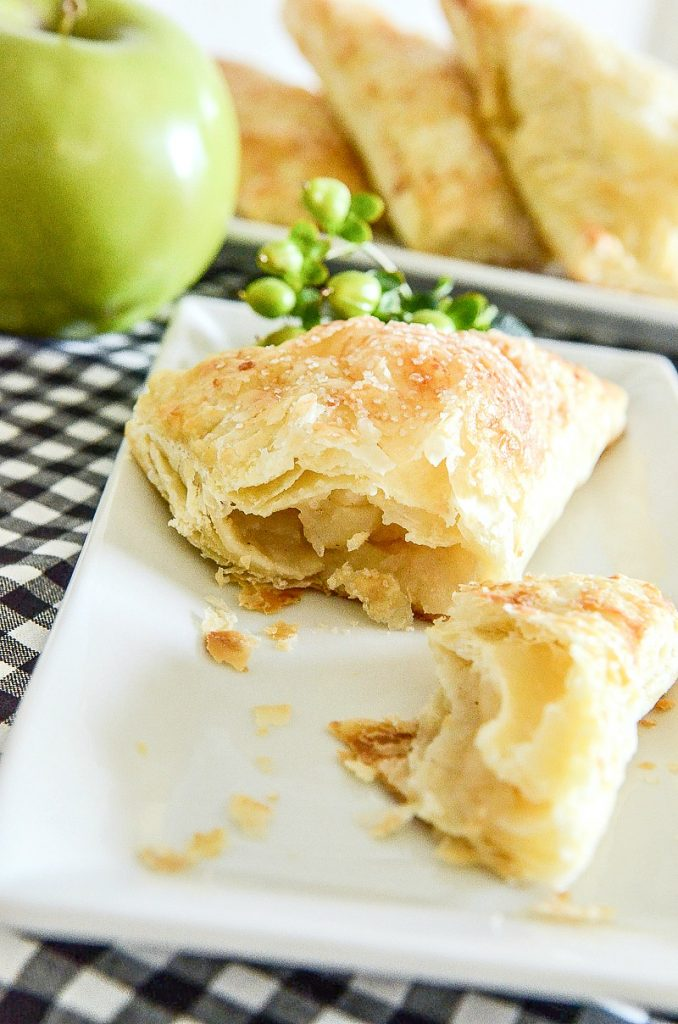 cut apple turnover on a white plate